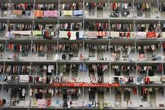 <p>Laundry hangs outside a student dormitory at a college in Wuhan, Hubei province March 5, 2009. REUTERS/Stringer</p>