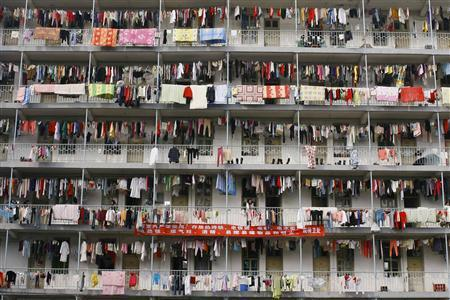 Laundry hangs outside a student dormitory at a college in Wuhan, Hubei province March 5, 2009. REUTERS/Stringer