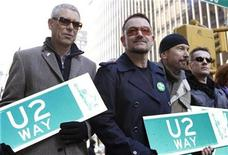 <p>Members of the rock group U2, Adam Clayton (L), Bono (2nd L), Edge (2nd R) and Larry Mullen (R), hold street signs after a portion of West 53rd Street was renamed U2 Way in New York, March 3, 2009. REUTERS/Gary Hershorn</p>