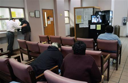 Patients wait for their appointments at a Health Center in Marrero, Louisiana December 8, 2005. REUTERS/Lee Celano