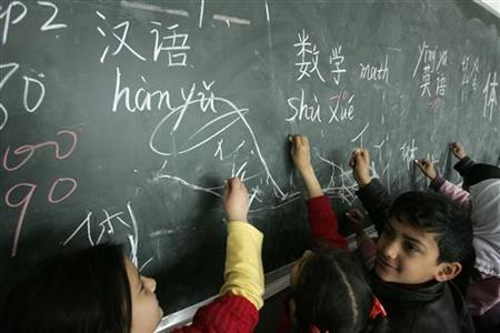 Students study Chinese characters at Qunxing international school in Yiwu, Zhejiang province March 7, 2008. REUTERS/Aly Song