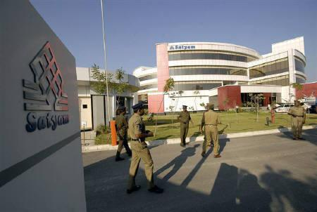 File photo of policemen outside the Satyam Computer Services head office in Hyderabad January 12, 2009. At least three Indian companies may bid for a majority stake in Satyam Computer Services Ltd, the fraud-hit Indian outsourcer looking for a strategic investor. REUTERS/Krishnendu Halder/Files