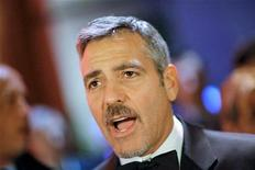 "<p>U.S. actor George Clooney arrives on the red carpet for the German telethon ""Ein Herz fuer Kinder"" (A heart for children) in Berlin December 6, 2008. REUTERS/Johannes Eisele</p>"