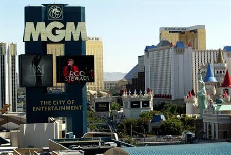 A sign for the MGM Grand casino stands in front of casinos (R) owned by the Mandalay Resort Group on The Strip in Las Vegas, Nevada, June 14, 2004. REUTERS/Steve Marcus/ Las Vegas Sun