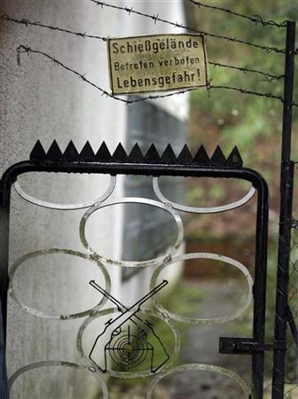 The back entrance gate of the shooting club of the 17-year old Albertville-Realschule gunman is pictured in Leutenbach near Winnenden March 13, 2009. A 17-year old gunman went on a shooting spree at his former secondary school, the Albertville-Realschule in Winnenden in southwest Germany on Wednesday, killing up to 16 people before dying himself in a shootout with police. REUTERS/Michael Dalder