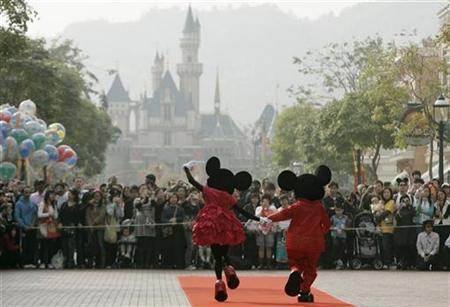 Mickey Mouse and Minnie Mouse characters greet visitors with their latest Year of the Mouse costumes at Hong Kong Disneyland January 21, 2008. REUTERS/Bobby Yip
