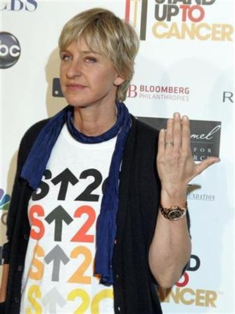 Talk show host Ellen DeGeneres shows her wedding ring as she arrives at the Stand Up To Cancer broadcast event in Hollywood September 5, 2008. REUTERS/Fred Prouser