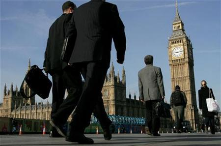 Commuters walk to work over Westminster Bridge in central London in a file photo. REUTERS/Toby Melville