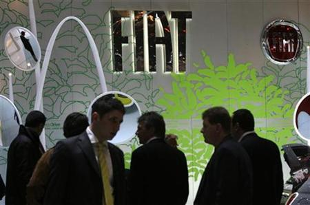 Visitors walk on the Fiat booth during the second media day of the 79th Geneva Car Show at the Palexpo in Geneva March 4, 2009. REUTERS/Denis Balibouse