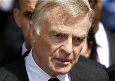 Max Mosley, president of the International Automobile Federation (FIA), Formula One's governing body, makes a statement as he leaves the High Court in central London July 24, 2008. REUTERS/Andrew Winning