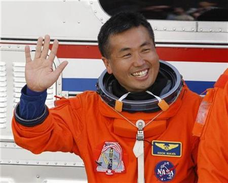 Space shuttle Discovery astronaut Koichi Wakata of Japan waves as he departs with other crew members for launch pad 39A at the Kennedy Space Center in Cape Canaveral, Florida, March 15, 2009. REUTERS/Scott Audette