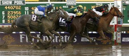 Ginger Punch with jockey Rafael Bejarano (R) drives past Hystericalady with jockey Eddie Castro (C) and Octave with jockey Garrett K. Gomez to win the Breeders' Cup Distaff race at Monmouth Park in Oceanport, New Jersey October 27, 2007. REUTERS/Tim Shaffer