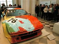 <p>Visitors crowd around the vintage BMW M1 car decorated by famous artist Andy Warhol in 1979 at an exhibition in The State Hermitage Museum in St.Petersburg on October 3, 2000. REUTERS/Str Old</p>