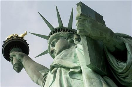 The Statue of Liberty after a press tour in New York, August 2, 2004. REUTERS/Chip East