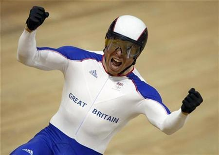 Chris Hoy of Britain celebrates after winning the gold medal in the men's sprint track cycling race at the Beijing 2008 Olympic Games in this August 19, 2008 file photo. REUTERS/Phil Noble