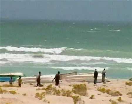 A video grab from an undated television footage shows pirates walking on the beach in the town of Eyl in the north of Somalia. REUTERS/Reuters TV