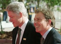 <p>Former President Bill Clinton and former British Prime Minister Tony Blair during a G8 summit in a 1997 photo. REUTERS/File</p>
