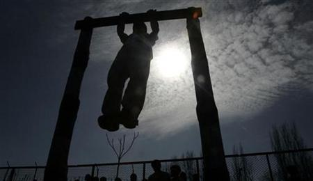 A youth exercises in this February 18, 2009 file photo. REUTERS/Danish Ismail