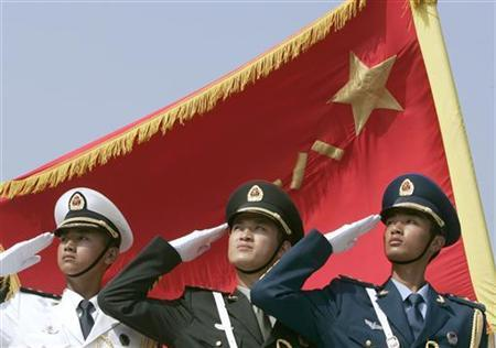 (L to R) Honor guards from the navy, land, and air force of the People's Liberation Army in formation in Beijing, August 1, 2007. REUTERS/Joe Chan