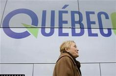 <p>Parti Quebecois leader Pauline Marois walks back to her bus following a campaign stop in Saint-Jean, Quebec on December 4, 2008. REUTERS/Christinne Muschi</p>