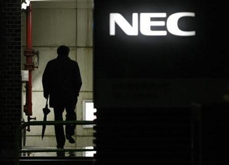 A man walks in front of the headquarters of NEC Corp in Tokyo January 30, 2009. REUTERS/Toru Hanai