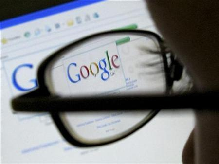 A Google search page is seen through the spectacles of a computer user in Leicester, England July 20, 2007. REUTERS/Darren Staples