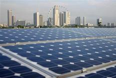 <p>Solar panels are pictured on the Marina Barrage building, with the Singapore Flyer observation wheel and office and hotel buildings pictured in the background, in Singapore in this March 25, 2009 file photo. REUTERS/Laurence SiMeng Tan</p>