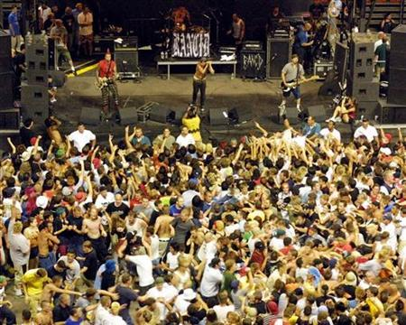Fans mosh in front of the stage as the punk rock band Rancid performs during the ''Vans Warped Tour 2001,'' at the Thomas & Mack Center in Las Vegas June 23, 2001. REUTERS/Ethan Miller