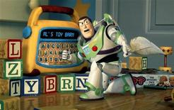 "<p>Buzz Lightyear uses a toy to plan a daring rescue of his pal Woody in Disney/Pixar's new computer animated comedy adventure film ""Toy Story 2."" REUTERS/HO Old</p>"