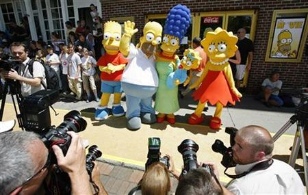 Characters in the film and television show ''The Simpsons'' pose for photographers in Springfield, Vermont July 21, 2007. REUTERS/Lucas Jackson