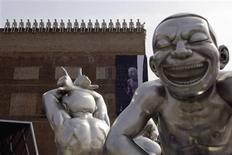 <p>Creations by Chinese artist Yue Minjun are seen outside the Today Art Museum in central Beijing in this March 26, 2009 file photo. REUTERS/David Gray/Files</p>