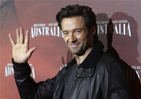 Hugh Jackman waves to the media in German cinemas on December 25. REUTERS/Tobias Schwarz