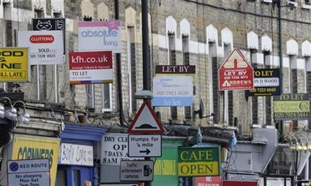Property letting and sale signs are seen above shops in south London in this file photo from January 13, 2009. REUTERS/Toby Melville
