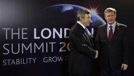 <p>Britain's Prime Minister Gordon Brown (L) greets Canadian counterpart Stephen Harper upon his arrival at the G20 summit at the ExCel centre, in east London April 2, 2009. World leaders are set to declare an end to unfettered capitalism at a G20 summit on Thursday after France and Germany demanded they act fast on promises to prevent a repeat of the worst economic crisis since the 1930s.. REUTERS/Stefan Wermuth</p>