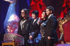 <p>(From L-R) Ozzy, Kelly, Sharon and Jack Osbourne stand on stage at the Brit Awards at Earls Court in London February 20, 2008. REUTERS/Alessia Pierdonemico</p>