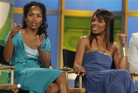 Executive producer Mara Brock Akil (L) and actress Wendy Raquel Robinson, star of The CW network's comedy series ''The Game'' take part in a panel discussion at the Television Critics Association press tour in Pasadena, California, July 17, 2006. REUTERS/Fred Prouser