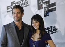 """<p>Atores do filme """"Velozes e Furiosos 4"""" Paul Walker e Jordana Brewster em Madri. 25/03/2009. REUTERS/Susana Vera</p>"""