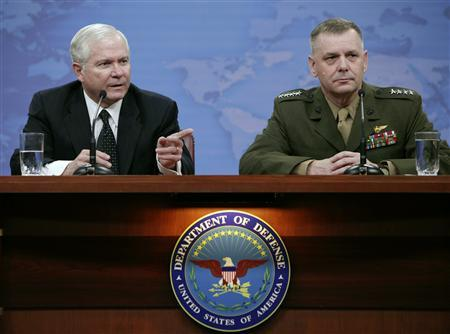U.S. Secretary of Defense Robert Gates (L) speaks during a joint news briefing with Gen. James Cartwright, Vice Chairman of the Joint Chiefs of Staff, on FY2010 budget recommendations at the Pentagon in Washington April 6, 2009. REUTERS/Yuri Gripas
