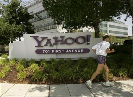 A man runs past the headquarters of Yahoo in a file photo. REUTERS/Robert Galbraith