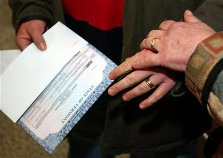 Lesbian couple Dr. Elizabeth Recupero (L) and Judith Levinson (R) show off their wedding rings and certificate of Civil Union issued in Vermont, while waiting for the Asbury park emergency City Council meeting on March 10, 2004. REUTERS/Chip East