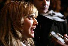 <p>Actress Brittany Murphy and her husband Simon Monjack (rear) speak to the media before the Max Azria 2008/2009 fall collection show during New York Fashion Week February 4, 2008. REUTERS/Carlo Allegri</p>