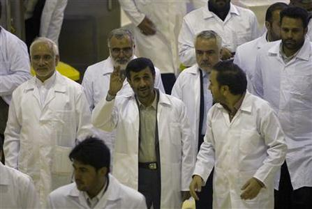President Mahmoud Ahmadinejad waves during a tour of the Fuel Manufacturing plant at the Isfahan Uranium Conversion Facility 440 km (273 miles) south of Tehran April 9, 2009. REUTERS/Caren Firouz