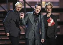 <p>Members of Green Day, Mike Dirnt (L), Tre Cool (C) and Billie Joe Armstrong (R) present the Grammy for Album of the Year at the 51st annual Grammy Awards in Los Angeles, February 8, 2009. REUTERS/Lucy Nicholson</p>