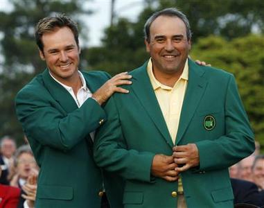 Angel Cabrera (R) of Argentina is presented his green jacket by Trevor Immelman (L) of South Africa after winning the Masters following final round play at the 2009 Masters golf tournament at the Augusta National Golf Club in Augusta, Georgia, April 12, 2009. REUTERS/Hans Deryk