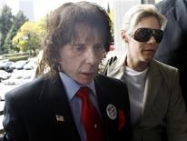 <p>Music producer Phil Spector and wife Rachelle arrive at the criminal courts building in Los Angeles April 13, 2009. REUTERS/Fred Prouser</p>