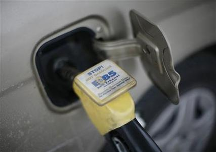 E85 ethanol fuel is shown being pumped into a vehicle at a gas station selling alternative fuels in the town of Nevada, Iowa in this December 6, 2007 file photo. Proponents say corn ethanol for transportation fuel is far better for the environment, national security and the economy than oil and the first step toward cleaner fuel sources. REUTERS/Jason Reed/Files