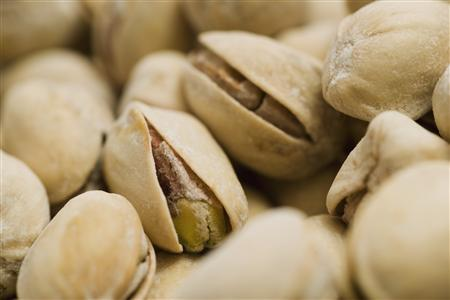 Pistachio nuts are shown in closeup in this undated handout photo. REUTERS/Newscom