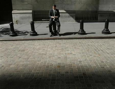 A trader sits outside the New York Stock Exchange October 6, 2008. REUTERS/Shannon Stapleton