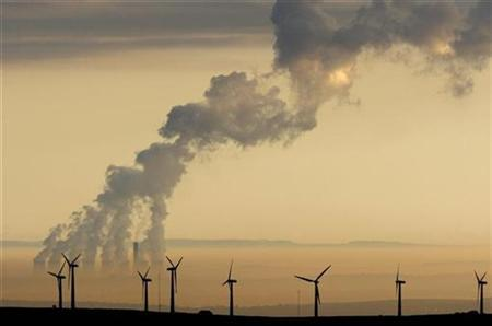 Steam rises from a power station behind the Royd Moor Wind Farm in Penistone near Sheffield, northern England, in this October 19, 2007 file photo. REUTERS/Phil Noble/Files