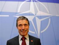 """<p>Новый генсек НАТО Андерс Фог Расмуссен на пресс-конференции в Страсбурге 4 апреля 2009 года. Афганские талибы назвали нового главу НАТО, датчанина Андерса Фога Расмуссена, """"главным врагом мусульман"""" за то, что в 2006 году тот выступил в защиту серии карикатур на пророка Мухаммеда, опубликованной в датской прессе. REUTERS/Philippe Wojazer</p>"""